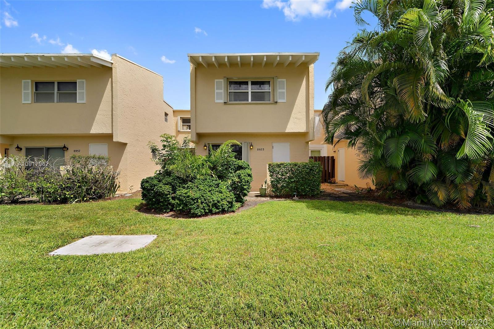 Updated Miami Shores Villa featuring open floor plan! Spacious Kitchen offers abundance of counter s