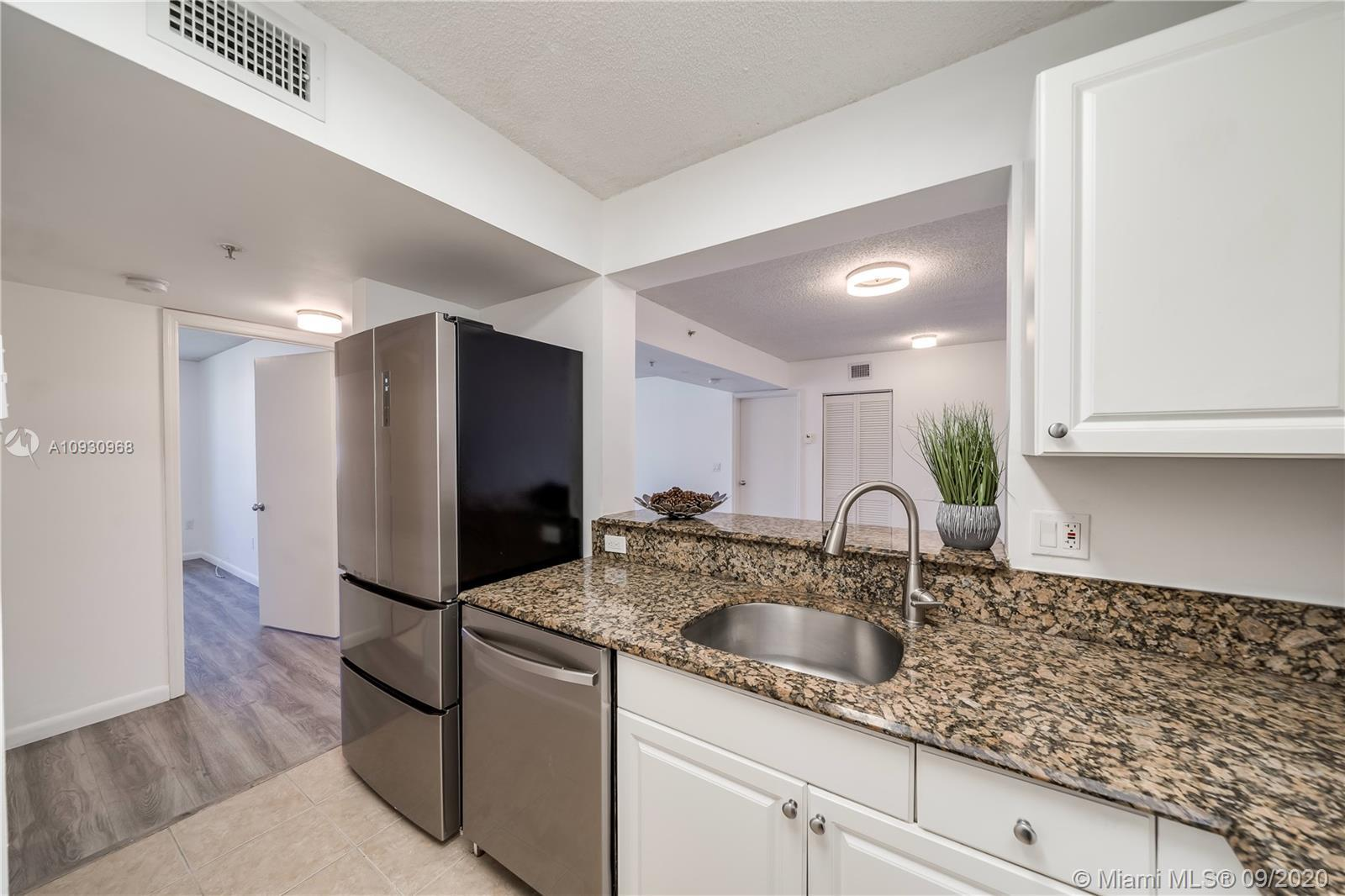 Totally renovated 2 bedroom apartment with new air conditioning, lighting, appliances, flooring, and