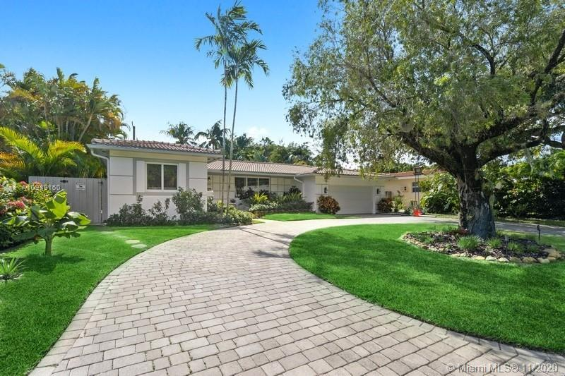 This stunning, completely updated home is located on a quiet park block just steps from all that Mor