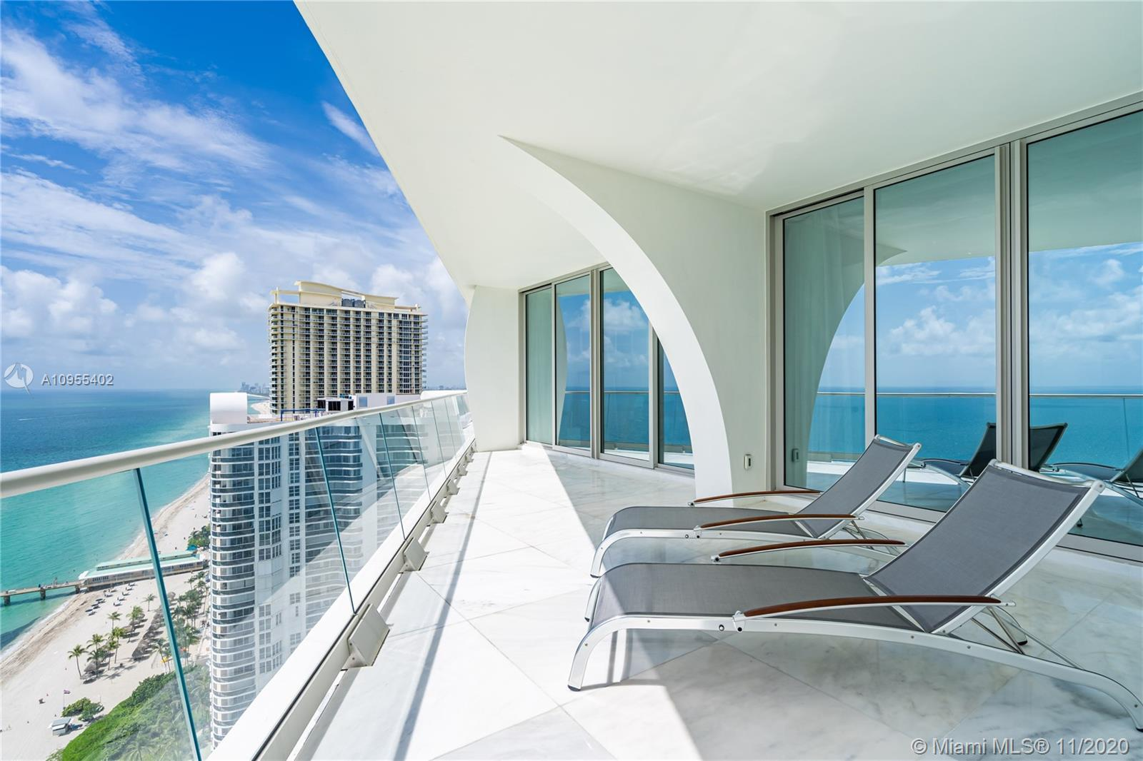 Breathtaking flow through unit with unobstructed Ocean and City views .Private elevator leads you to