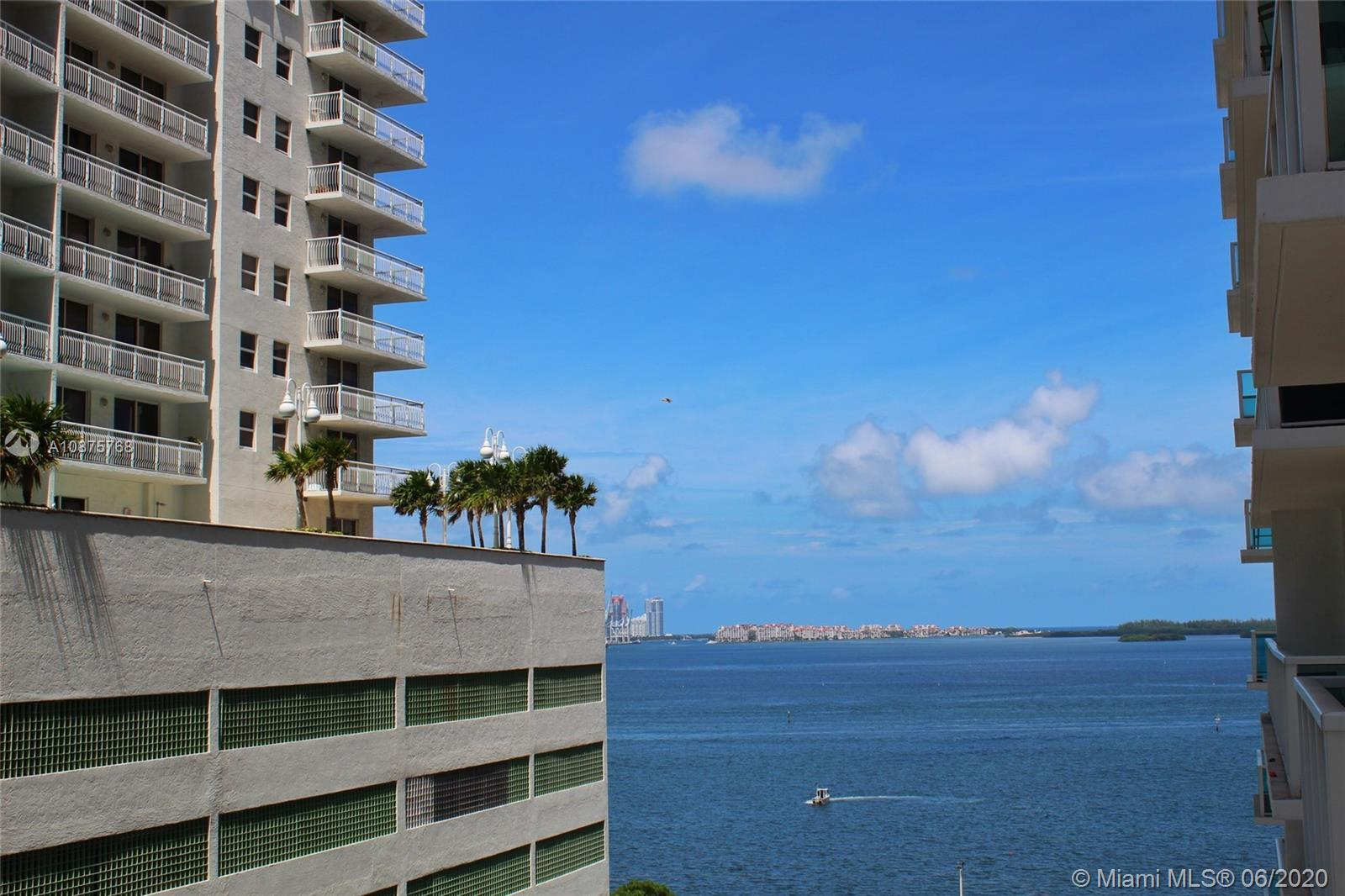 Turn-key CORNER UNIT on the 10th floor, with wrap around balcony offering spectacular views of the c