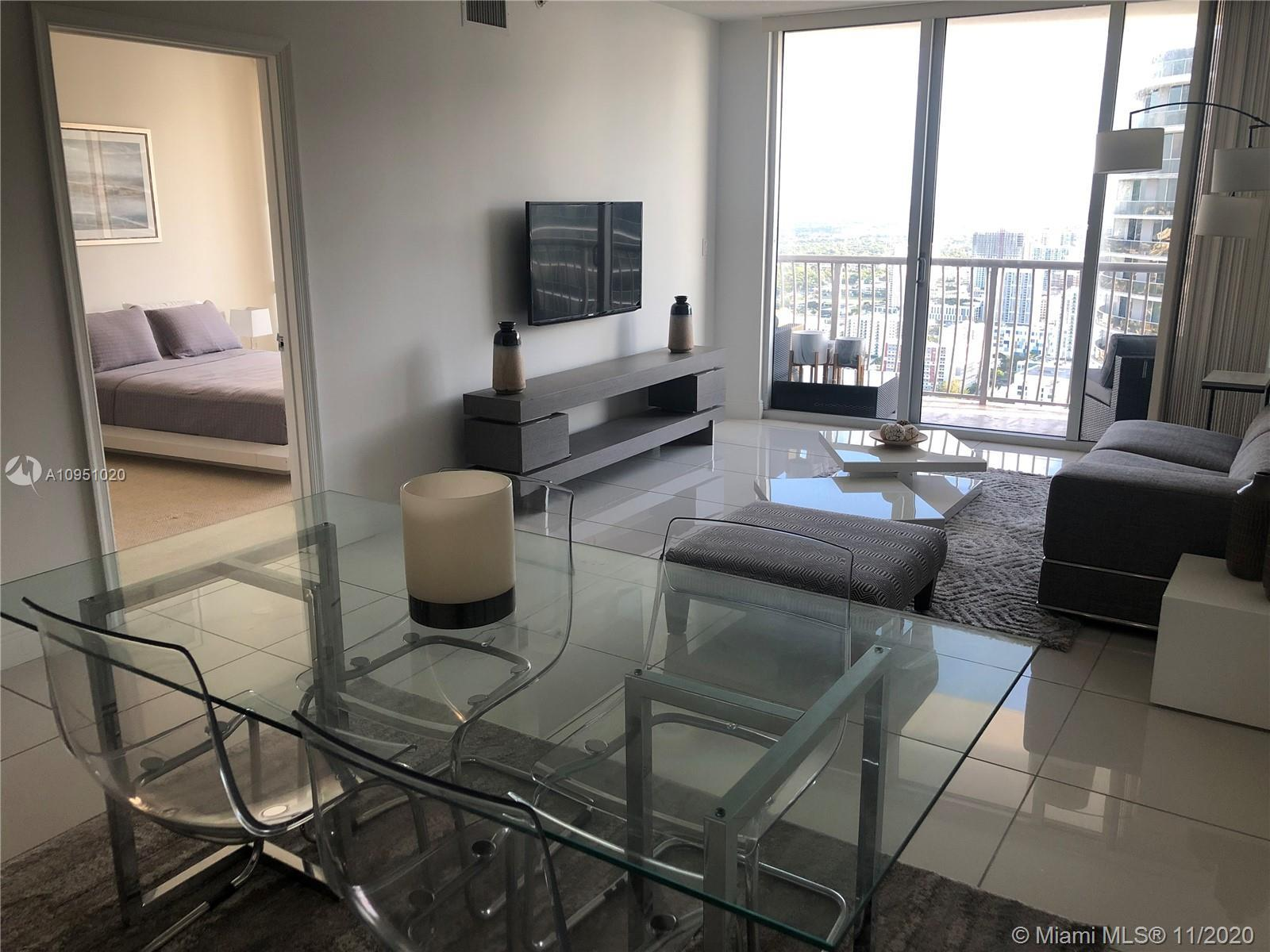Enjoy breathtaking views of the city and Biscayne Bay in this elegant and comfortable one-bedroom Pe