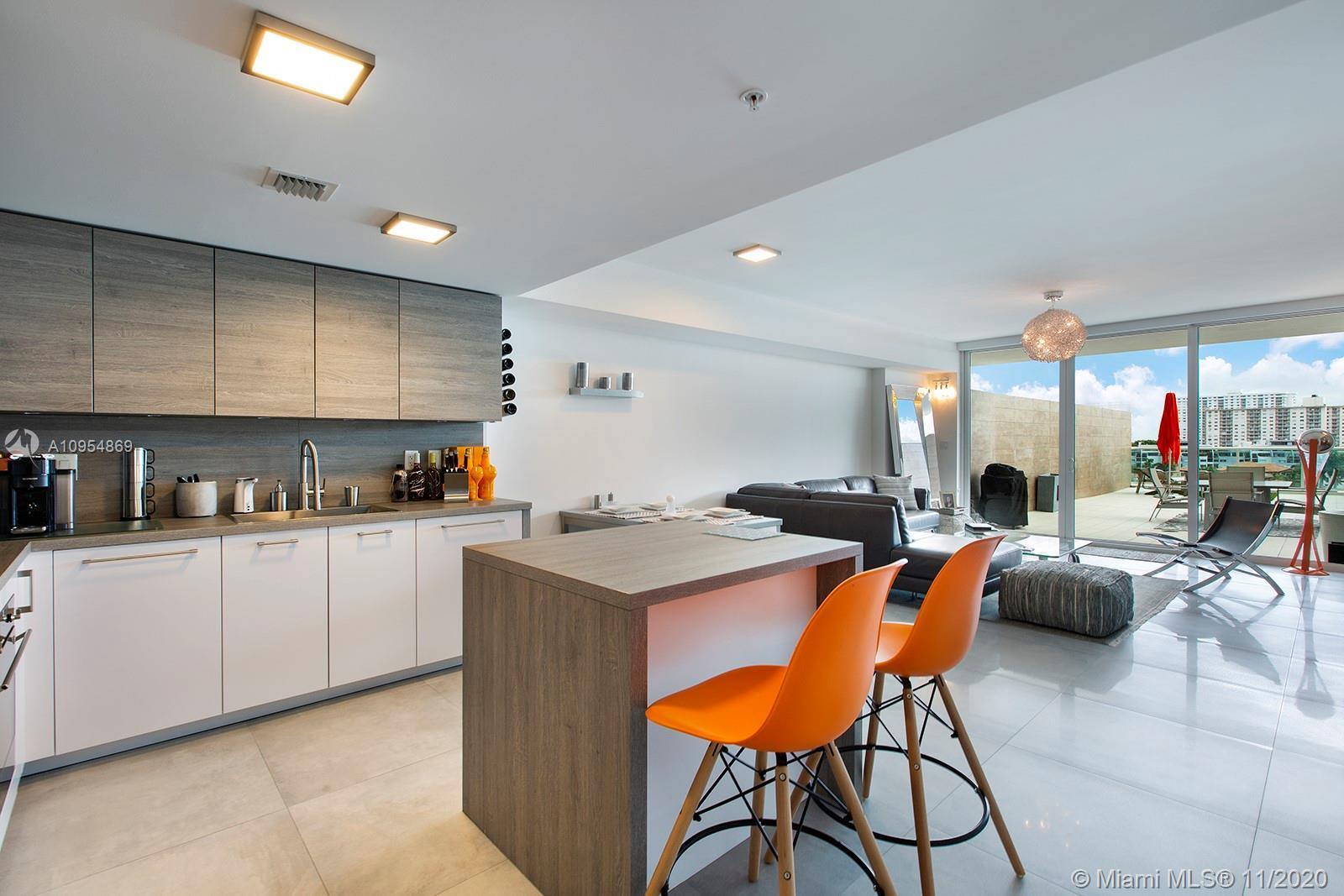 Immaculately maintained, impeccably designed residence in the heart of Sunny Isles Beach. Take in th