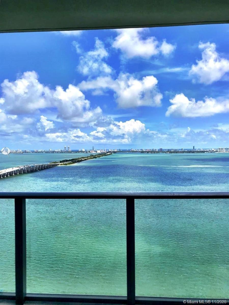 Breathtaking views from this flow through Bay front condo offering 3/3.5 bath + den in One Paraiso!