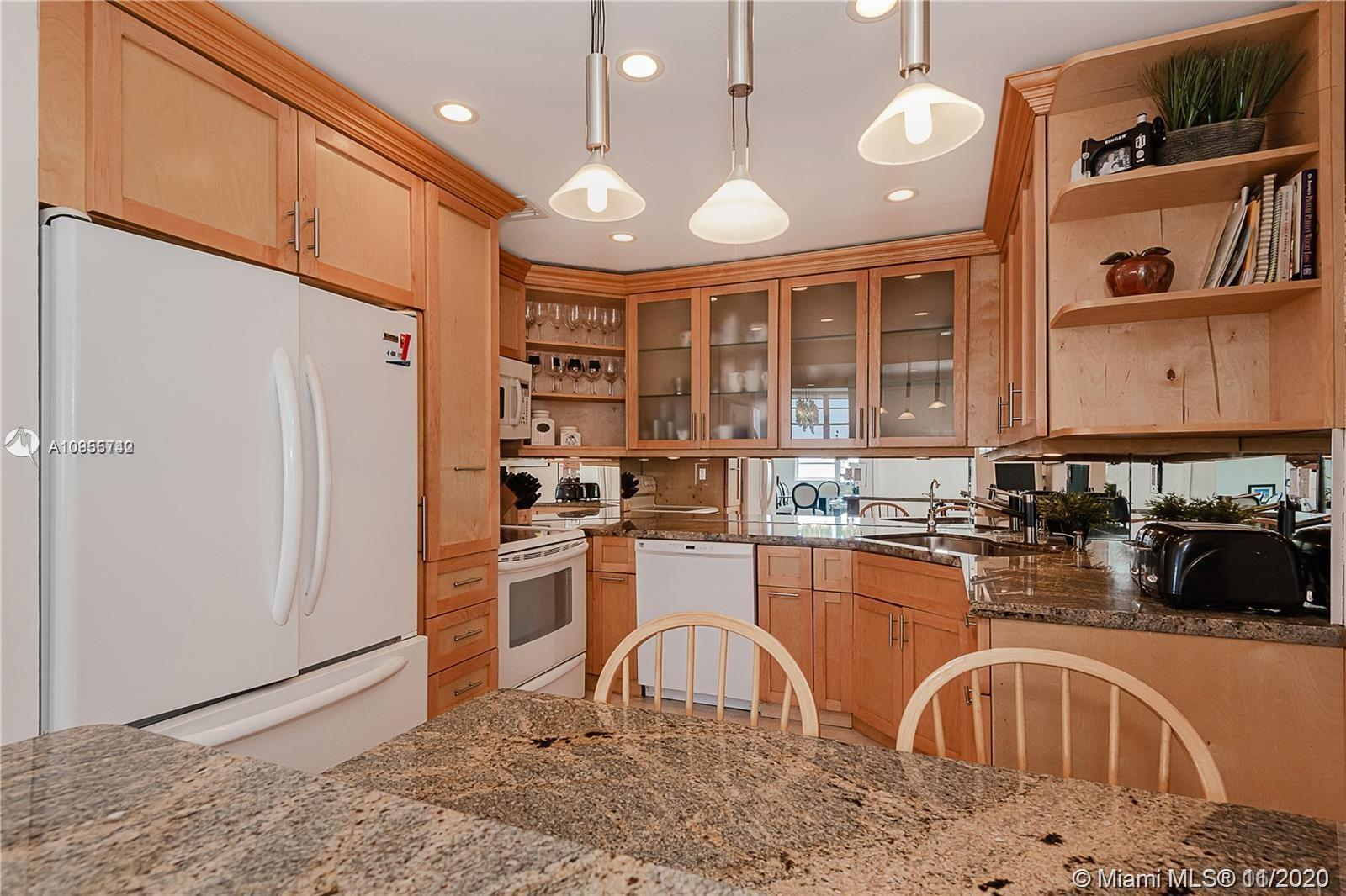 Beautiful and bright 3 bedrooms 2 1/2 bathrooms corner residence with a million dollar view. located