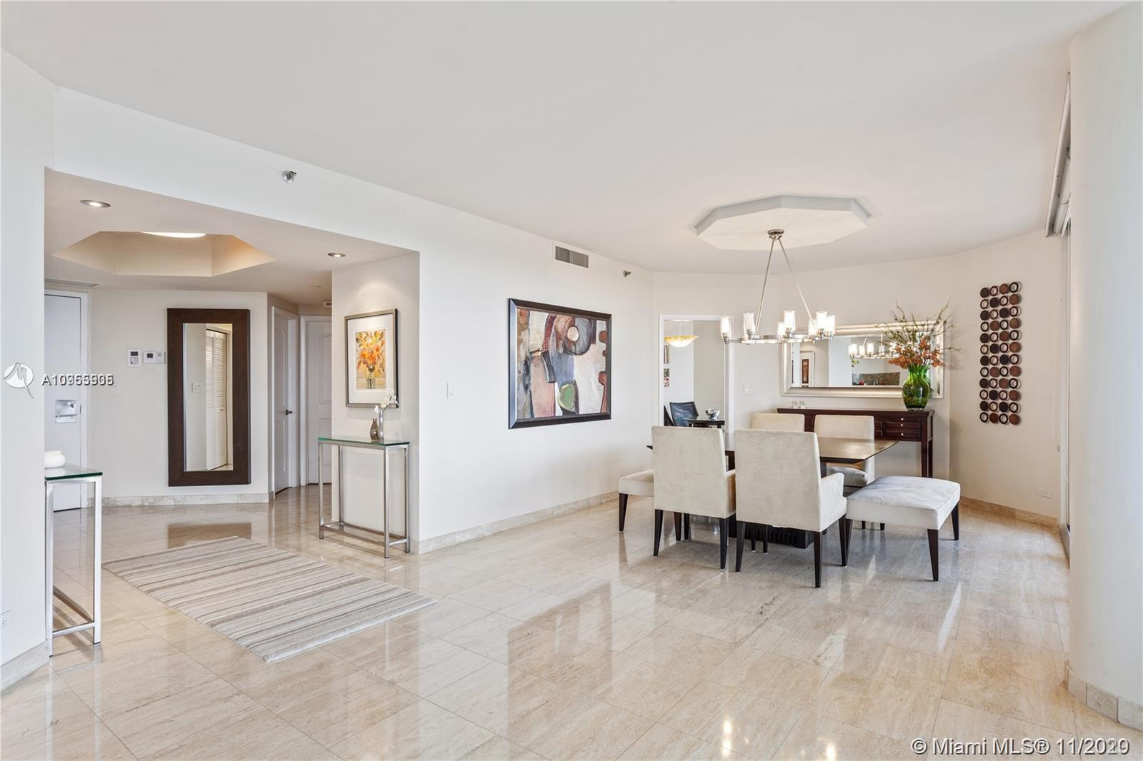 Beautifully remodeled, corner unit with direct water views of the Intracoastal Waterway! Oversized l