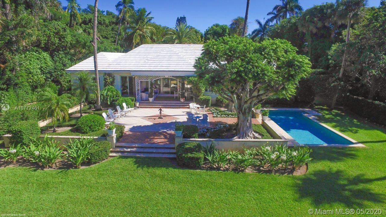 Be amazed at the tropical beauty of the 2.5+/- acre estate comprised of two deep parcels that provid