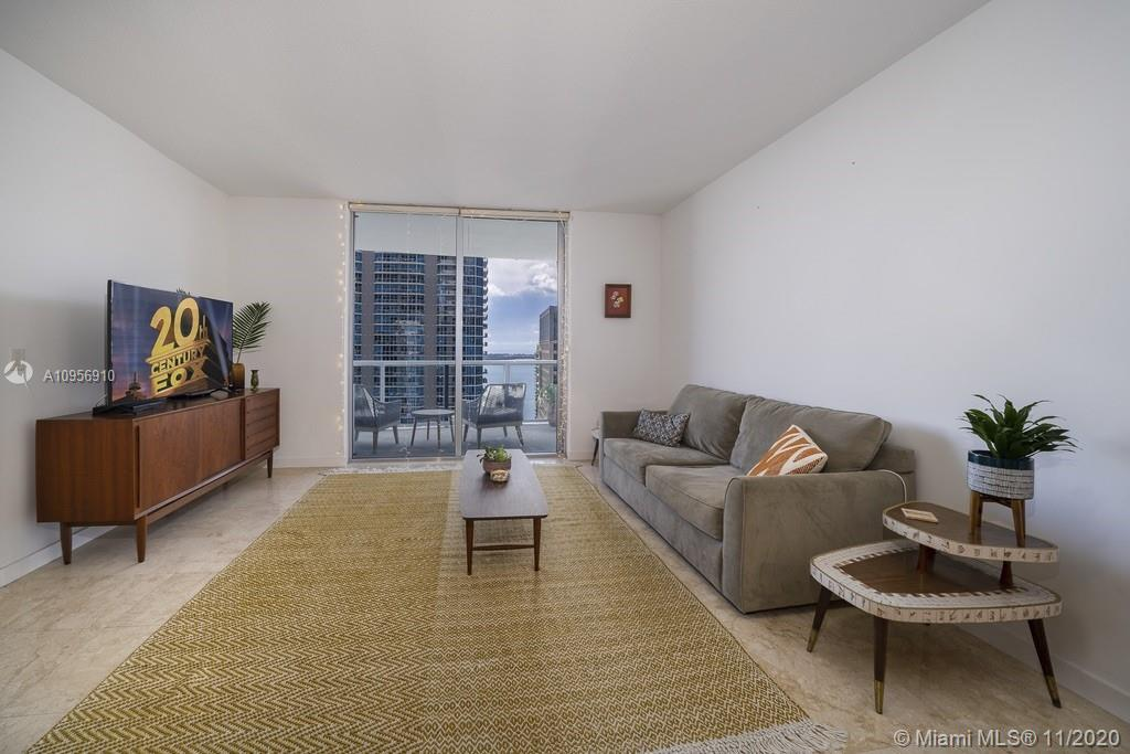 Charming & bright 1BD/1.5BA apt facing Brickell Av. with Bay & City views.  Brand new white porcelai