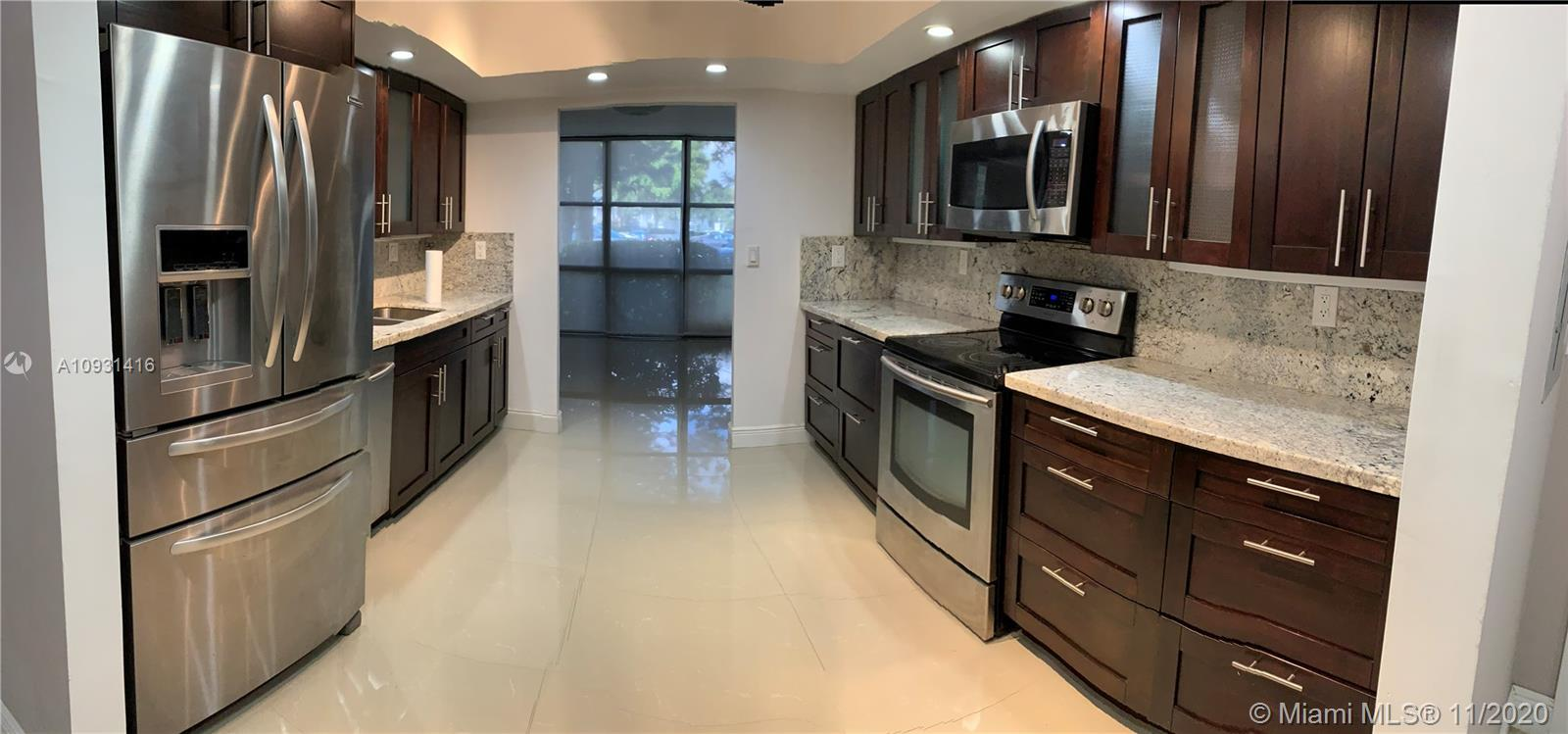 **ONE OF A KIND & FULLY RENOVATED, BRIGHT CORNER UNIT WITH DEN AND SEPARATE DINING ROOM AND LIVING R
