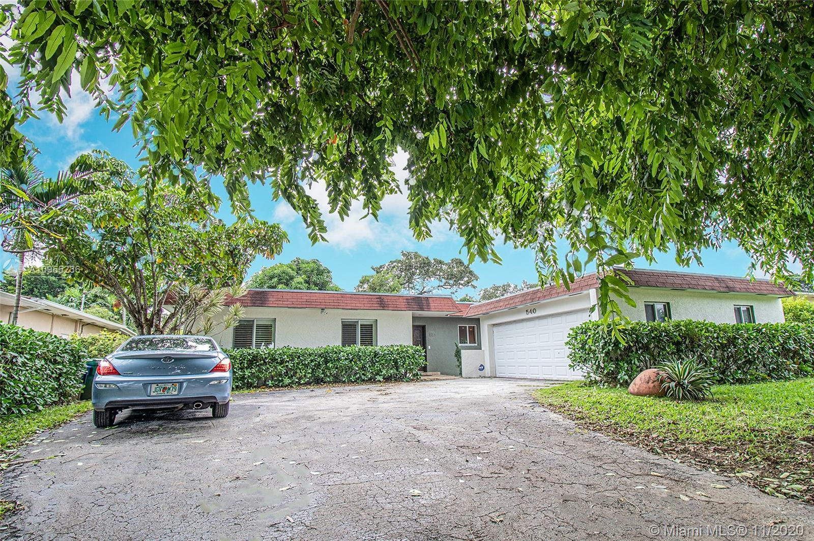 Beautiful home in Miami Shores that features 3 beds and 2 baths, laundry room with a tub, a 2 car ga