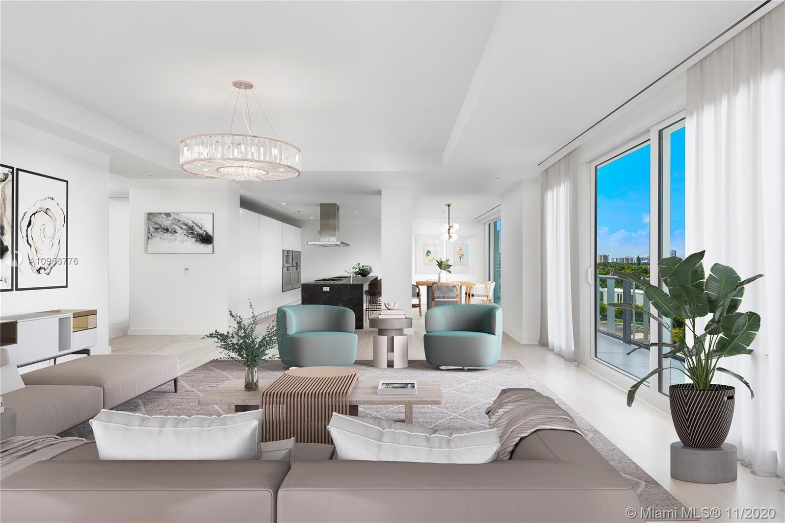 Light-filled, open, corner residence with floor-to-ceiling glass and stunning views of Biscayne Bay