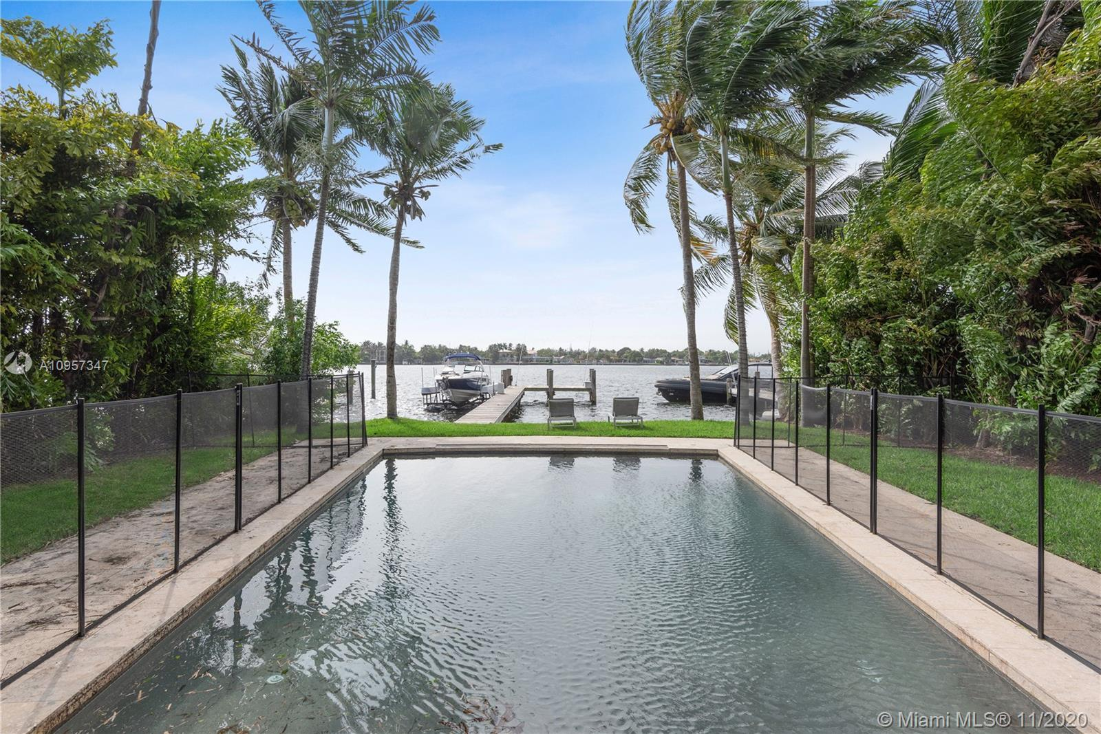 Beautiful waterfront home located in the wonderful gated community of Stillwater Drive, one of the m