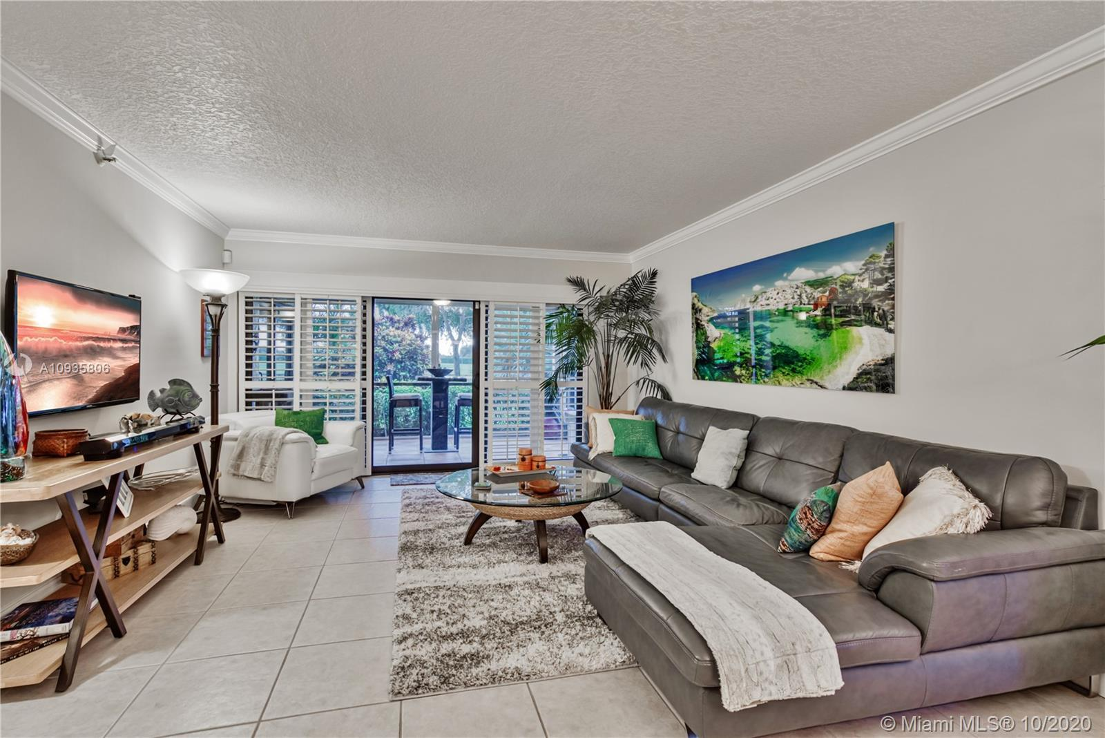 Rare and remodeled 3 bedroom 2 bath 1st floor unit at Club Royale @ Boca Del Mar steps away from the