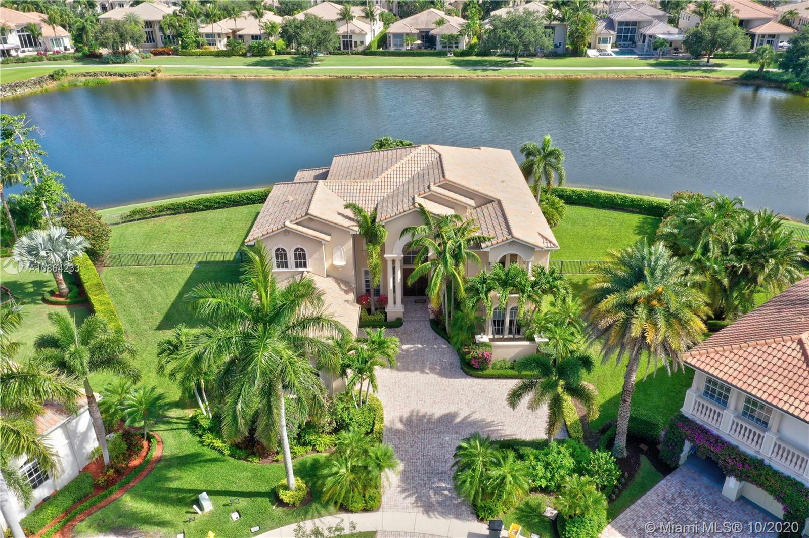 Live luxuriously in this estate home with sweeping views of the lake, golf course and resort style p