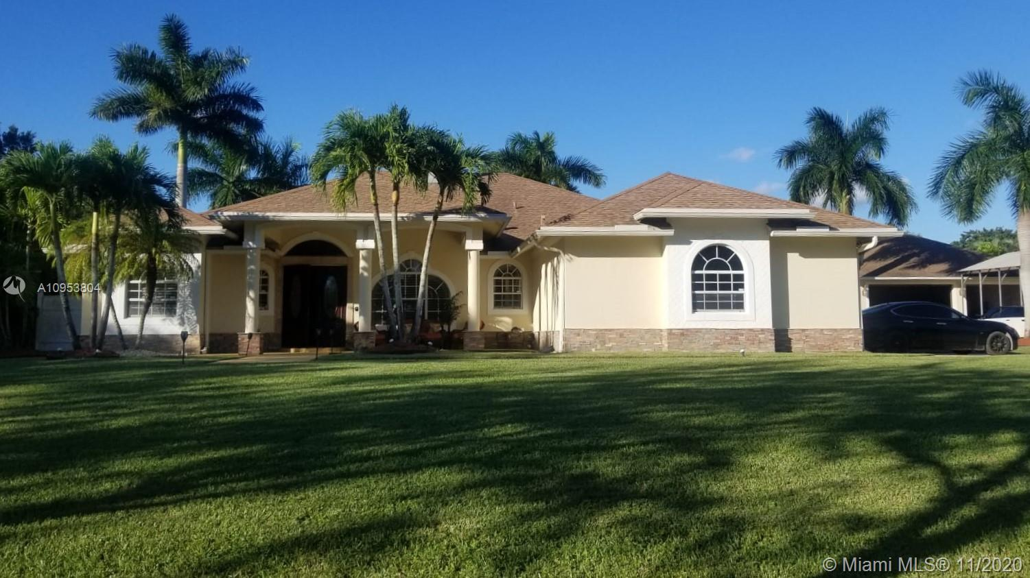 This gorgeous Acreage home with over 2,600 sqft is ideal for families looking to spread out, relax,