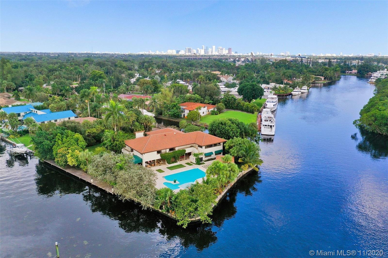With 540 Ft of wraparound deep water frontage and 41,635 Sqft of lushly landscaped land, this impres