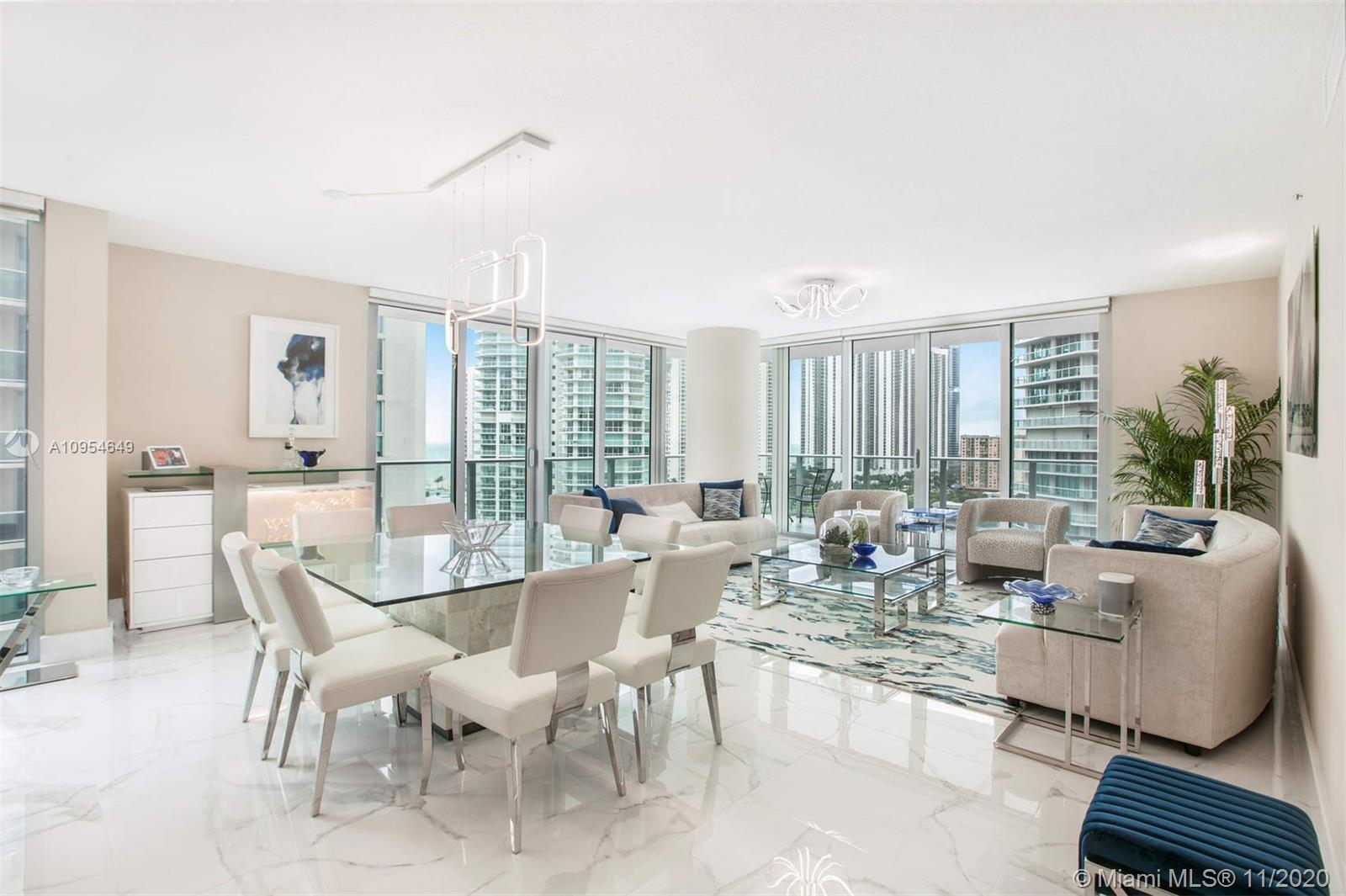 Stunning corner unit at Parque Towers in Sunny Isles within walking distance to the beach. This resi