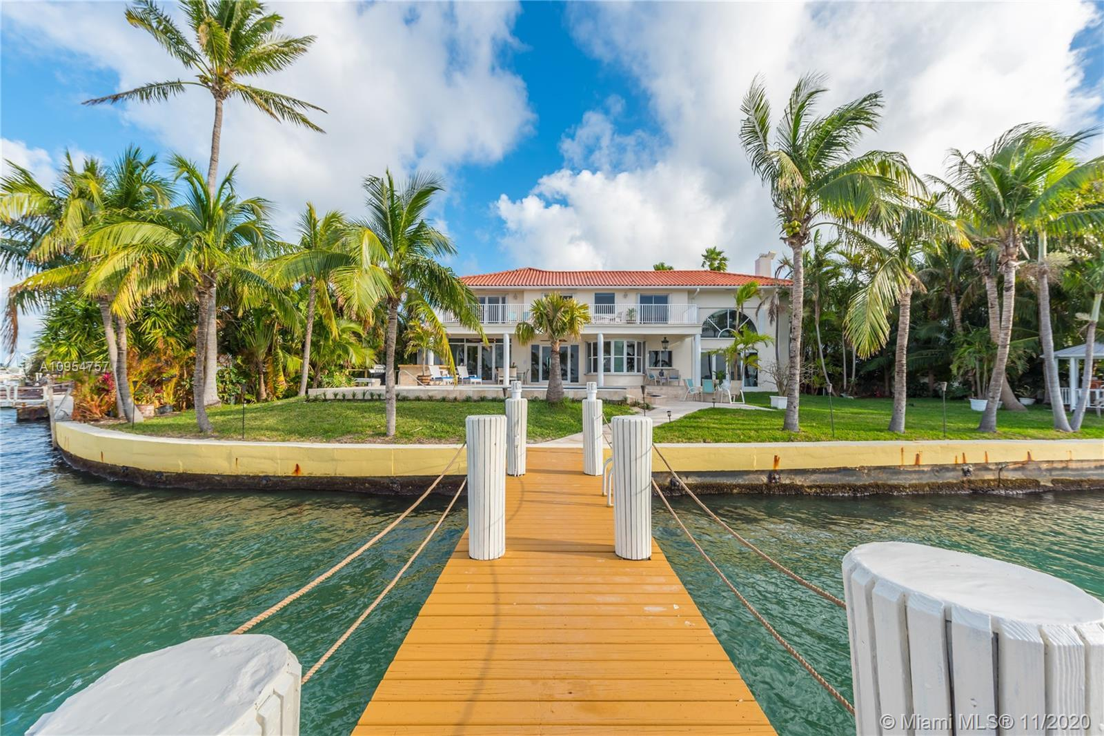 Exquisite home on peak of a gated street on a peninsula in Miami Beach. This 5/3.5 home offers safet