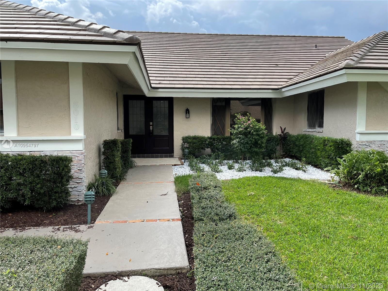 Freshly renovated and located in the desirable Woodfield Hunt Club in Central Boca, just minutes fro