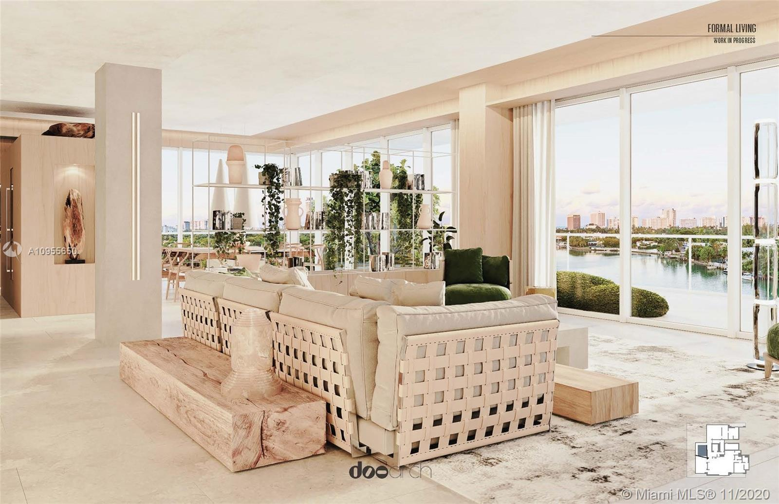 Biscayne Bay and Downtown views greet you as you enter this expansive light-filled corner residence.