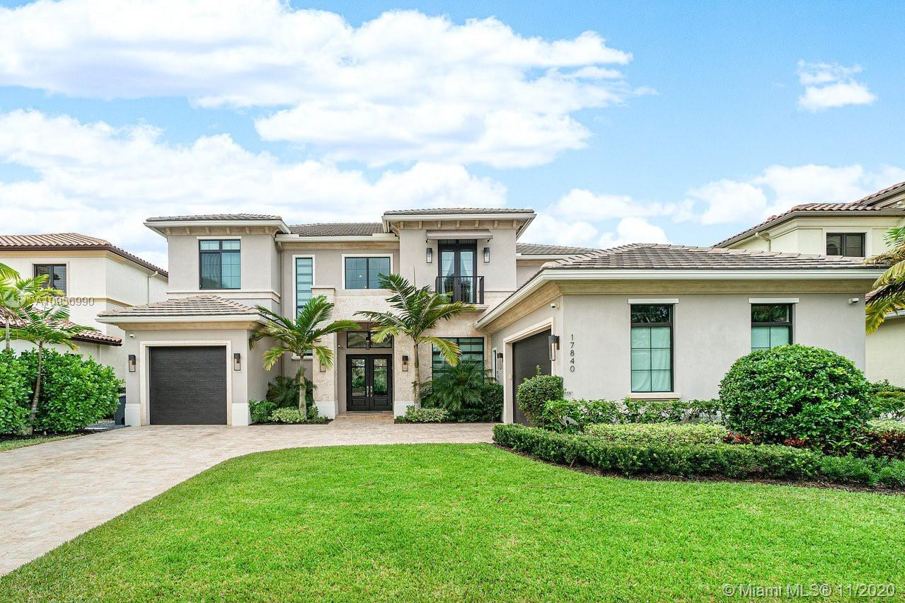 Absolutely stunning 2 story transitional estate in the highly sought-after Boca Raton gated communit