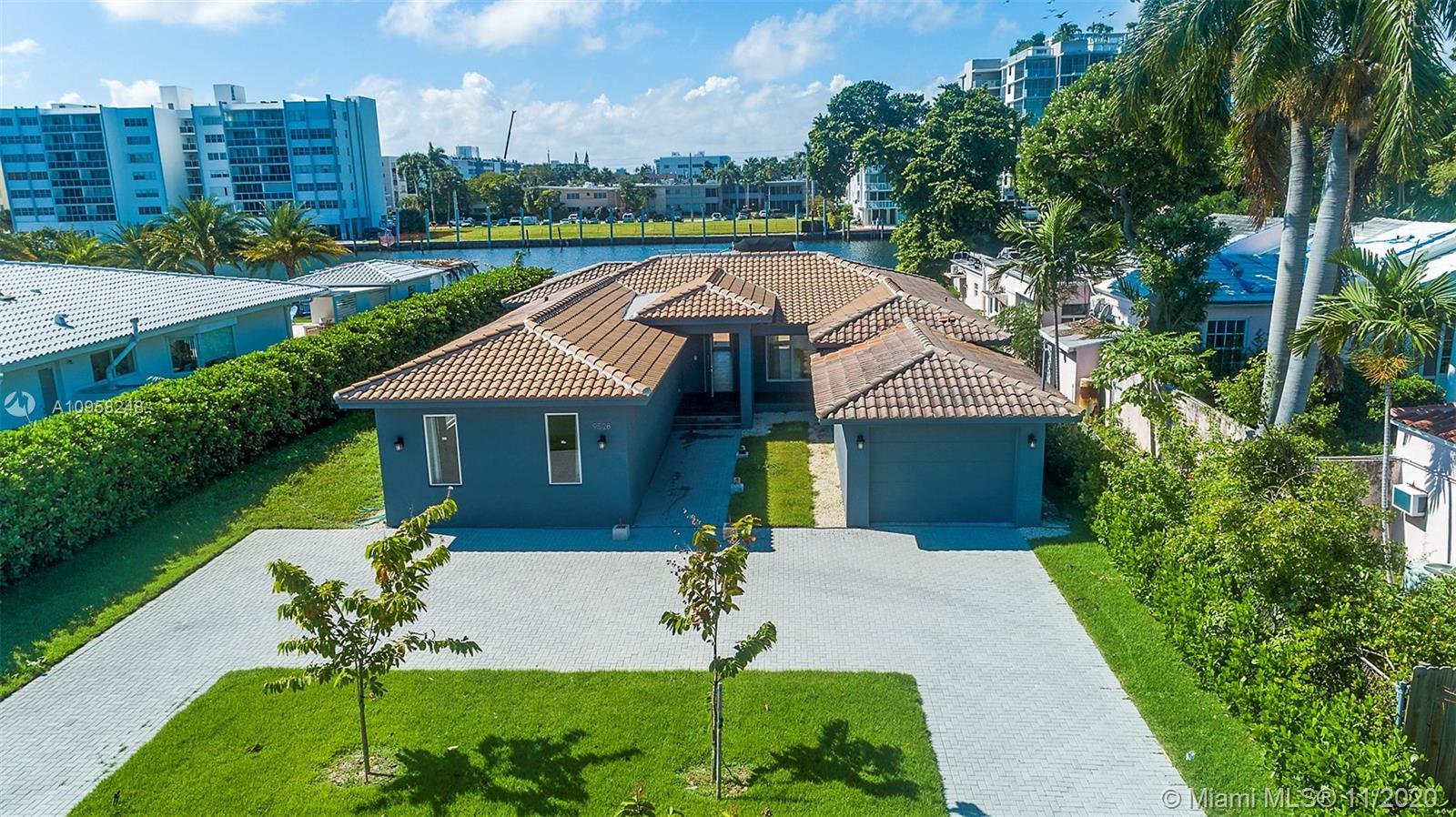 Gorgeous home located on 1.5 lots on the Intercoastal in the beach town of Surfside. Completely reno