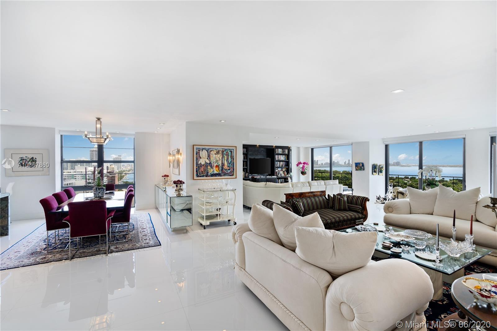 Remodeled corner residence offering panoramic intracoastal, Miami skyline, & Indian Creek Waterview