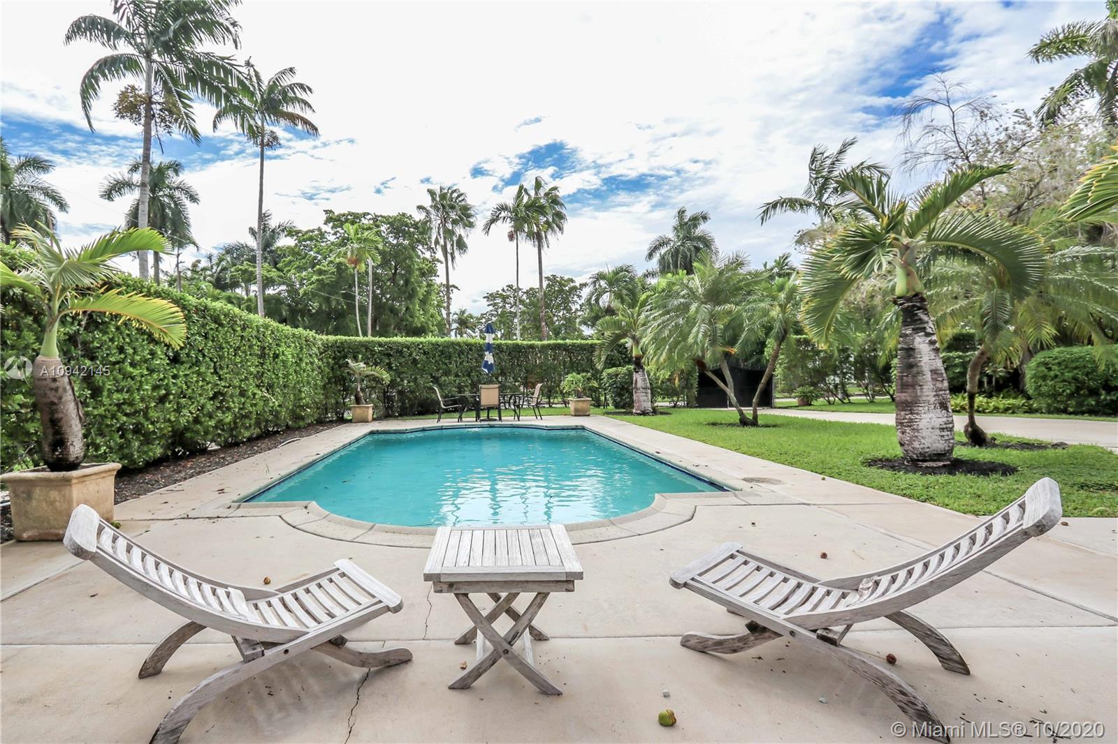 Stunning Art Deco 3 bedroom /2 bath home in Hollywood Lakes area. This double corner lot features a