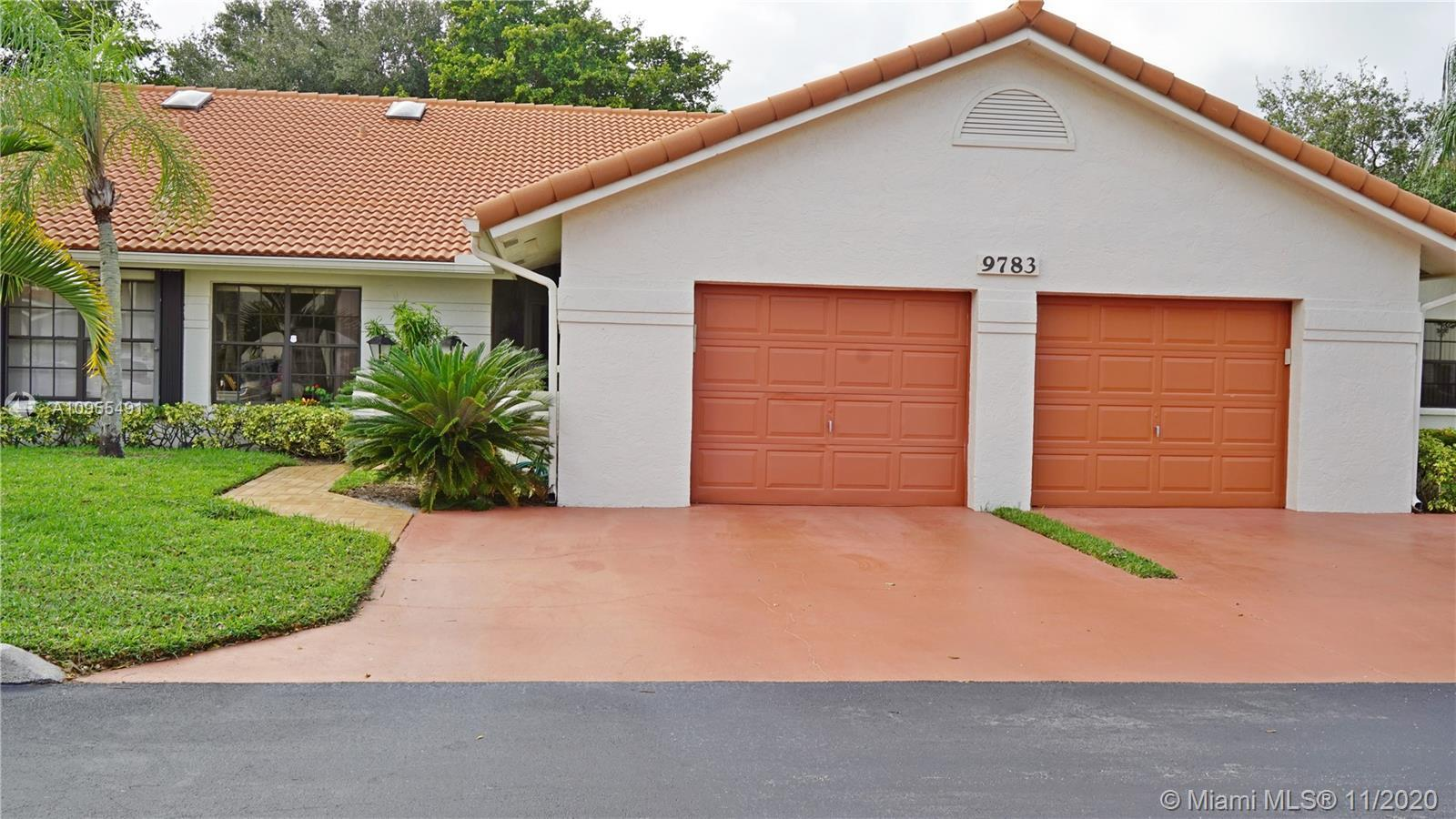 Extremely desirable two bedroom two bath villa with den/office . Updated nice size kitchen with an e
