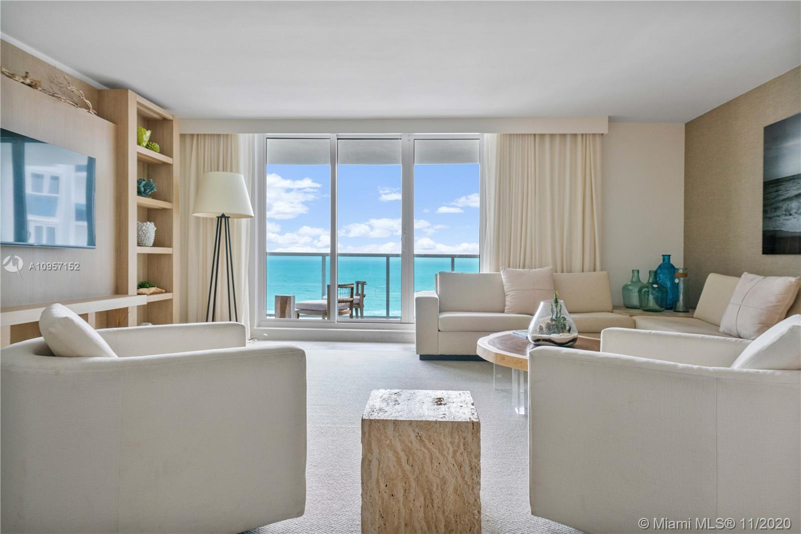 Stunning corner unit with direct ocean views ! 2 bedrooms, 2.5 bathrooms immaculately designed by ac