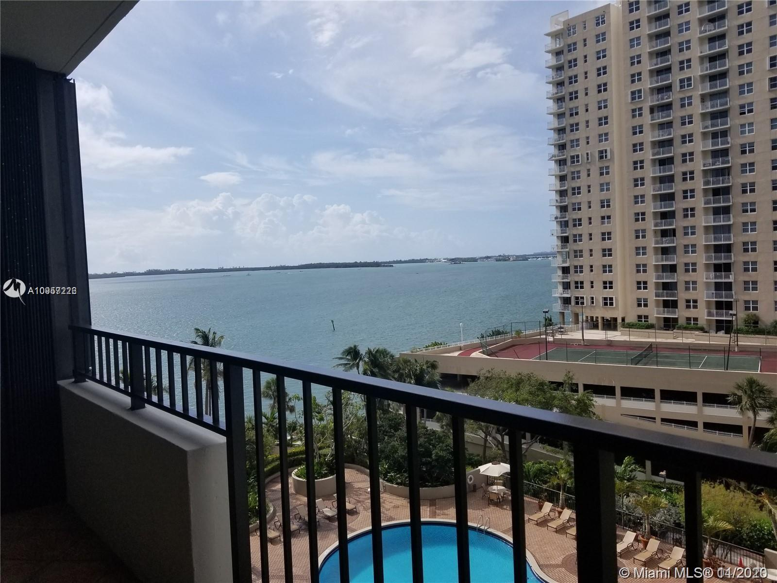 Unobstructed bay views from this spacious 2BD/2BA condo in private Brickell Key. Features open floor