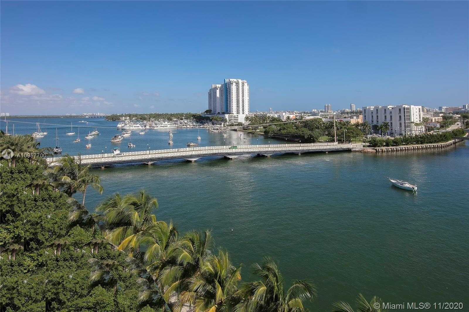 Bright, beautiful corner unit w/ water views from every window! 2BR+den/2BA in highly sought-after B