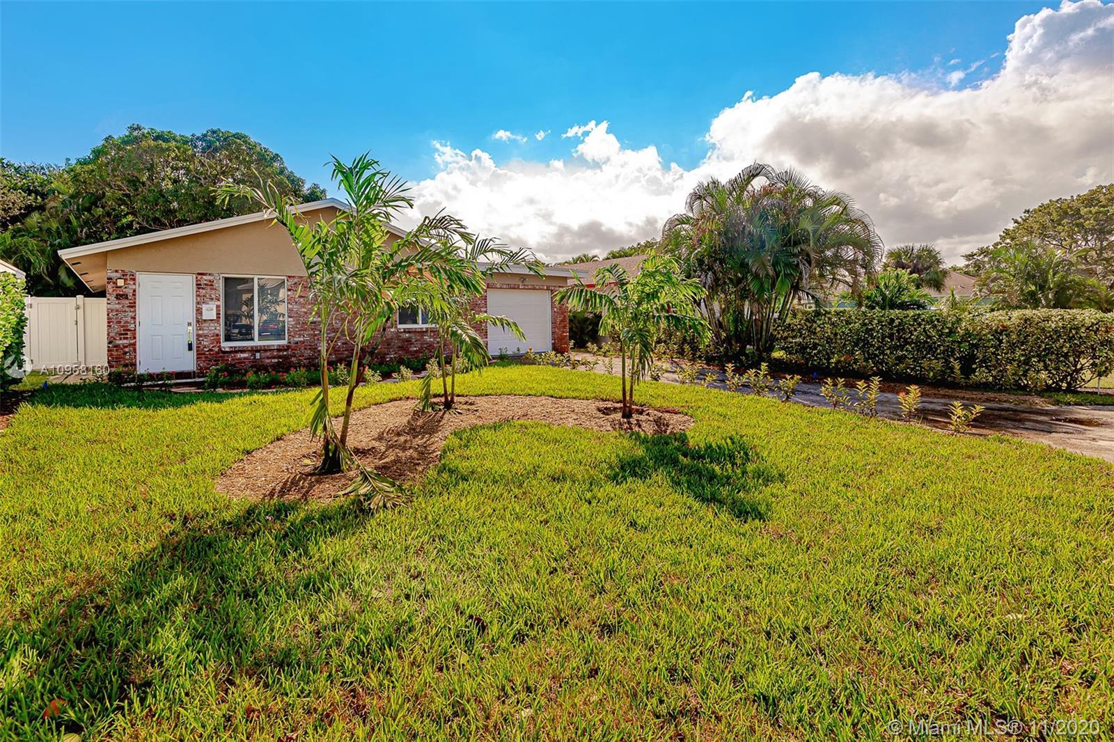 BEAUTIFULLY RENOVATED 3/2 GARAGE HOME IN BOCA RATON WITH BRAND NEW ROOF and HURRICANE IMPACT WINDOWS