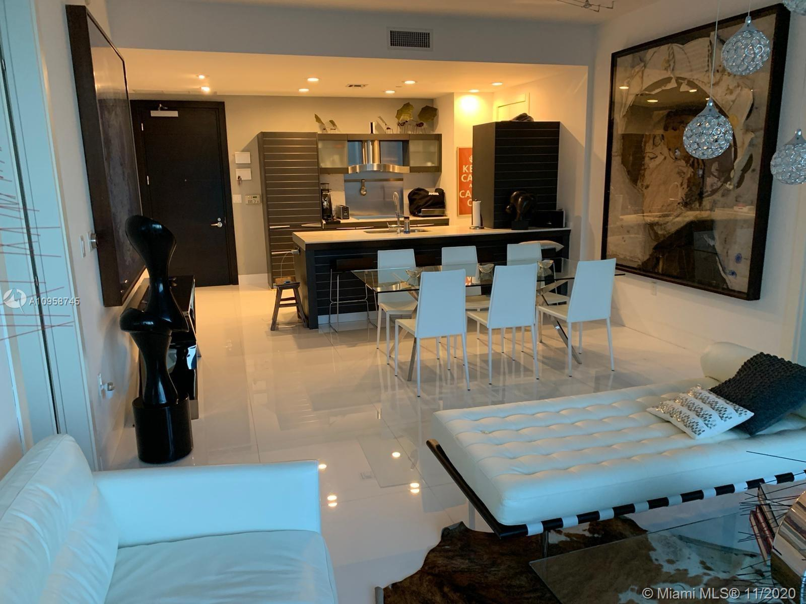 Luxury at it's finest. Spectacular city view 2 bedroom 2 bathroom + den with 1/2 bath condo in the e