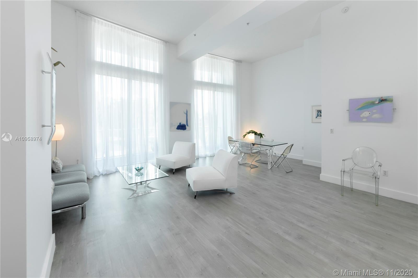 Elegant contemporary 1 Bedroom/1 Bath loft, features Italian kitchen cabinets with white corian tops
