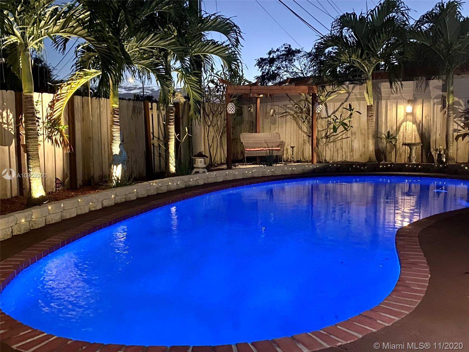 Beautiful pool home on a spacious corner lot with mature tropical trees.  This property has four bed