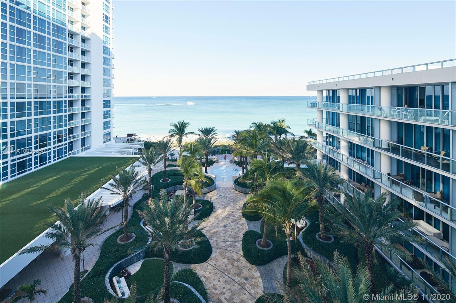 Spectacular 2 bedroom 2.5 bath unit in the luxurious Carillon lifestyle resort living. Floor to ceil