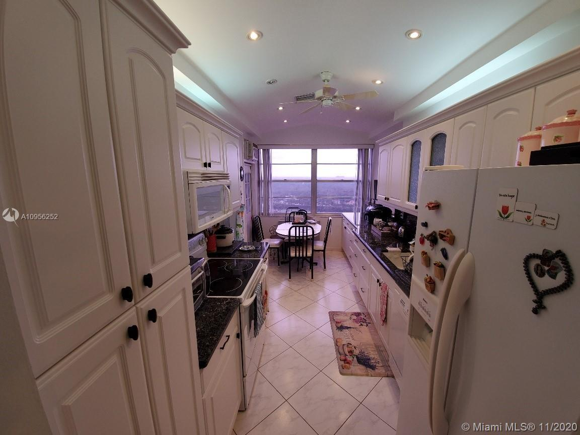 WELCOME AND SHOW THIS BEAUTIFUL AND WELL MAINTANED PENTHOUSE CORNER UNIT, 10TH FT CEILING, MARBLE FL
