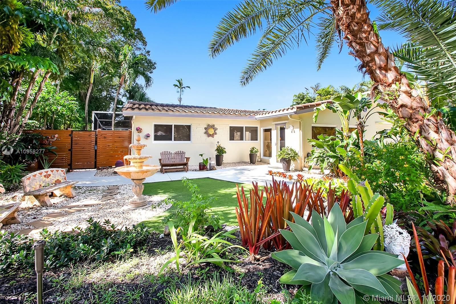 Magnificent Wilton Manors pool home with a beautifully landscaped courtyard that you might want to s