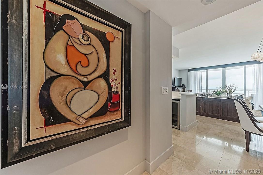 Completely renovated unit. Open Italian Chefs style kitchen, stainless steel appliances, marble floo