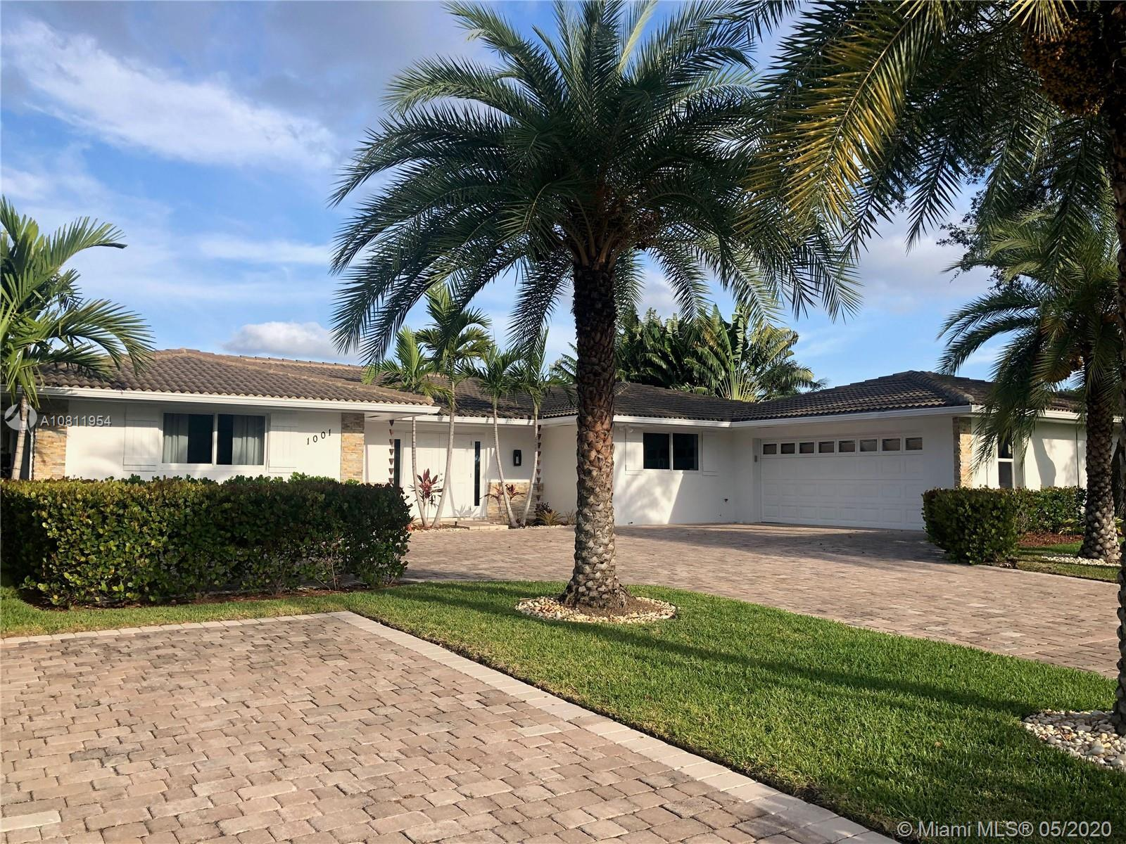 A 100% luxuriously renovated golf course home that is chic, open concept living with a bright kitche