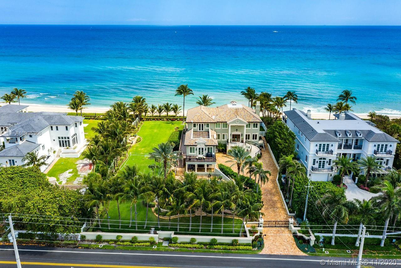 Indeed a mansion on Hillsboro Mile. Beach/Ocean front gated estate with 150 ft. docket/intracoastal
