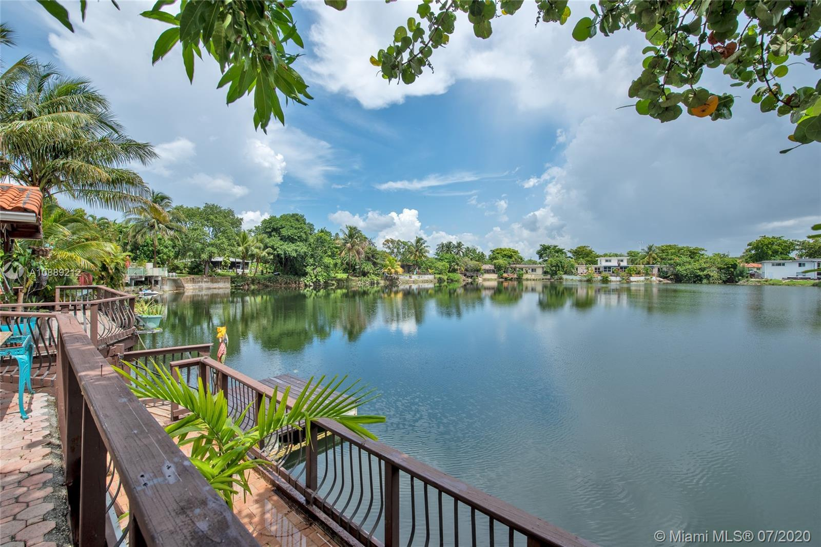 Beautiful lakefront home in Miami Springs! Features 3 bedrooms (possible 4th bedroom), 2 baths, impact resistant doors, accordion shutters on the windows, remodeled kitchen and baths, spacious deck overlooking the lake, carport, paver driveway and so much more!
