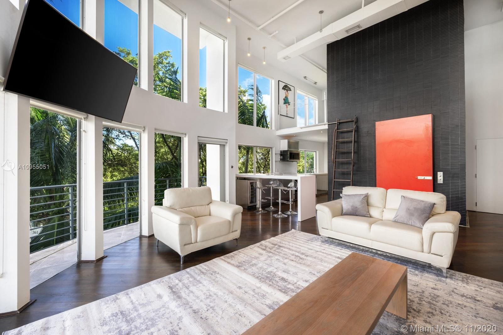 Manhattan Lofts #5 is a beautiful 2-story residence nestled in the heart of South of 5th. This premi