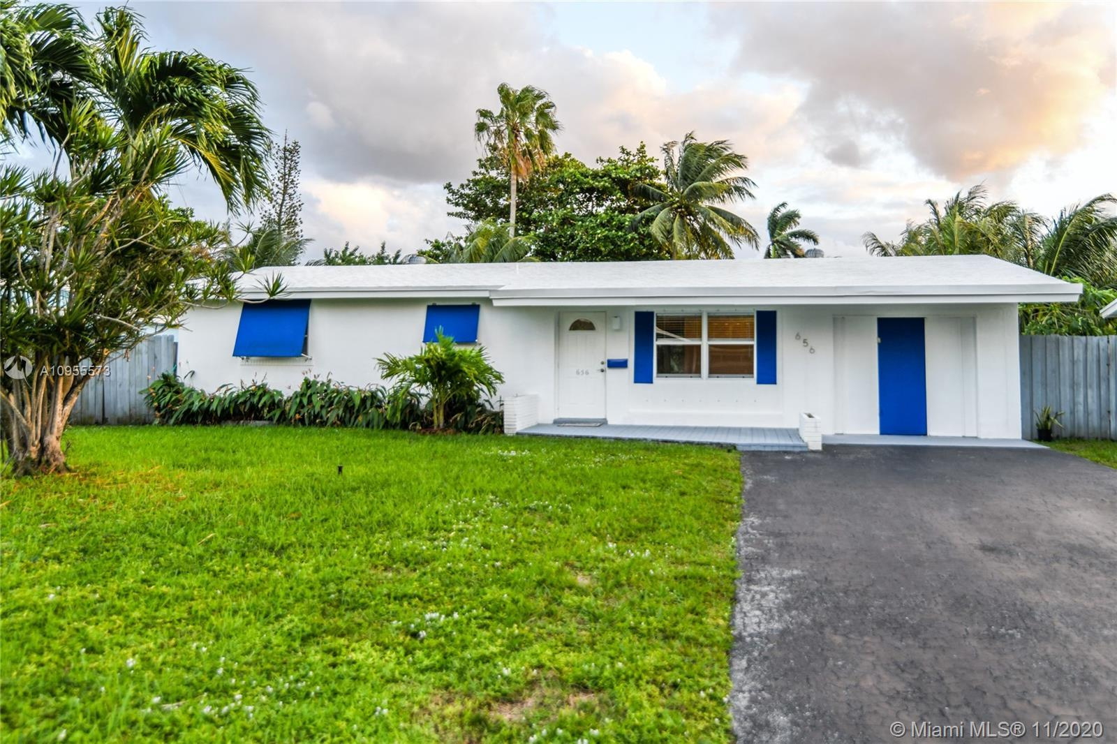 WATERFRONT HOME – Over 70 feet of Waterfront property on Middle River! This Riverfront Tropical Oasi
