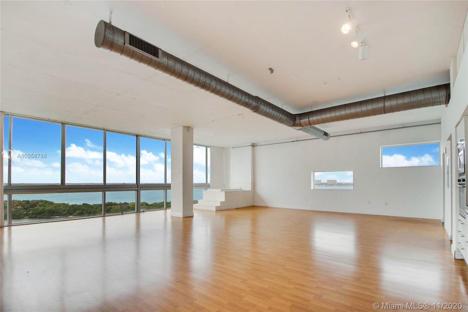 """Miami's ultimate loft building with massive """"space"""", vaulted 11' ceilings, and a wall of glass that"""