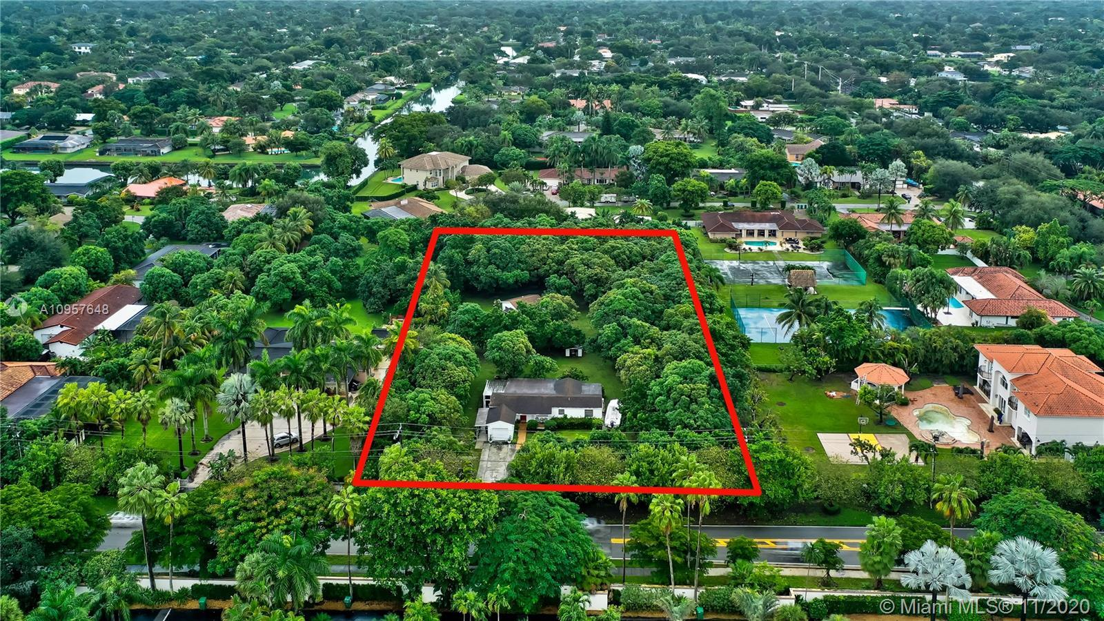 Live in highly desirable Pinecrest and build the home of your dreams on an expansive 1.59 acres with
