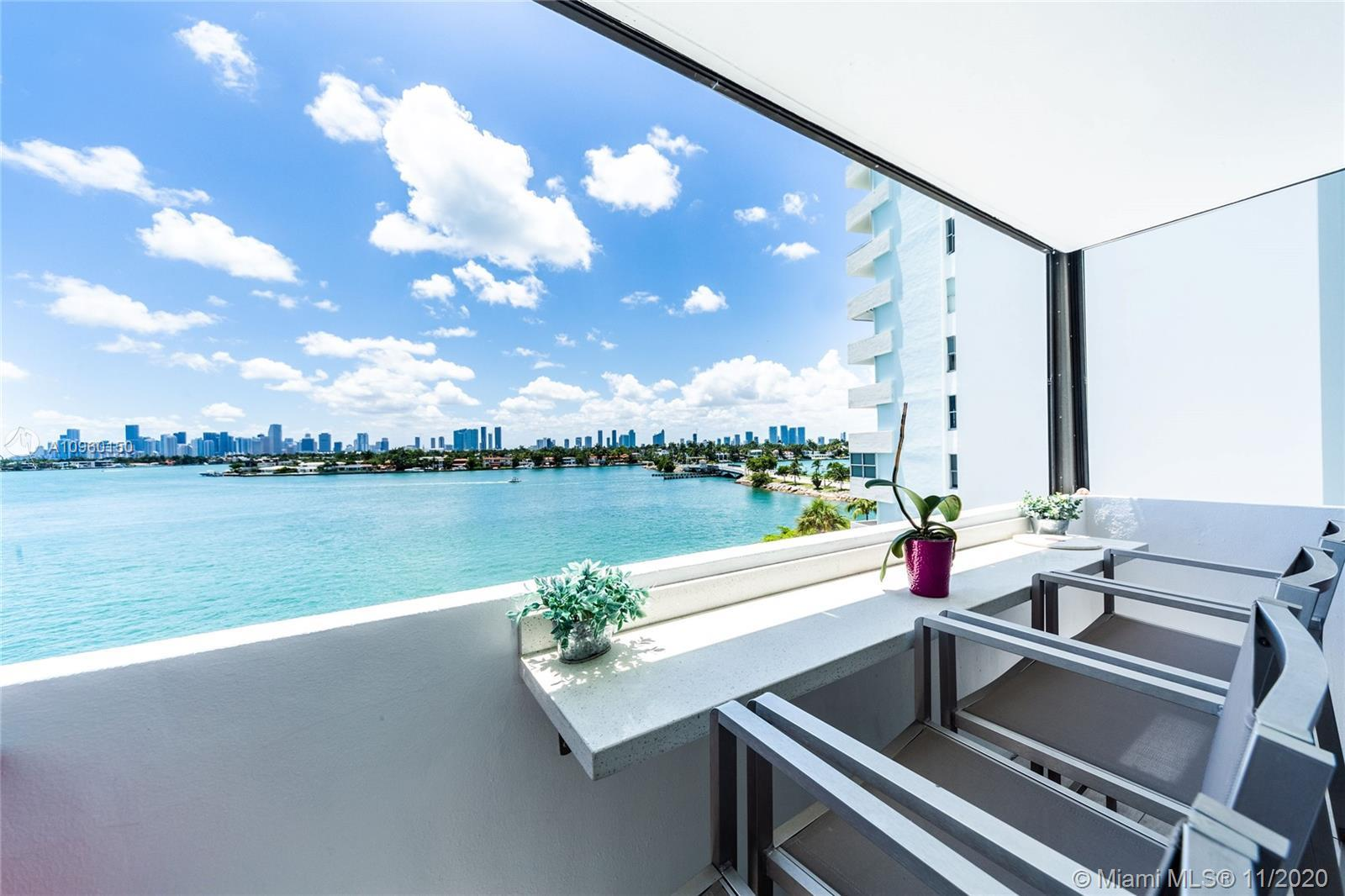 Fully updated corner unit at the exclusive Island Terrace Condo. Stunning views of Biscayne Bay and