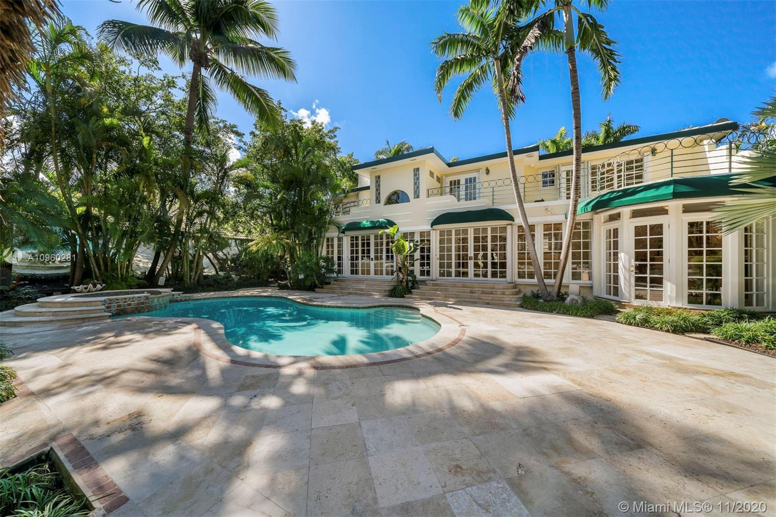 This 2-story Art Deco waterfront home on exclusive Pine Tree Drive is a must see. The 5BR/4+1BA home
