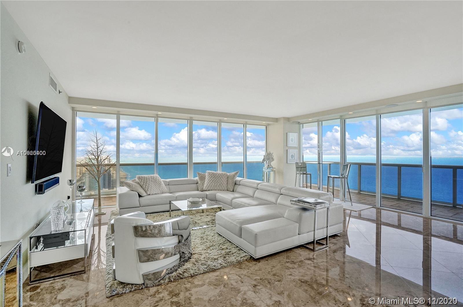 Gorgeous high floor turn-key Corner Unit, NE Direct Ocean views w/ wraparound terrace. 3 bed 3 bath,